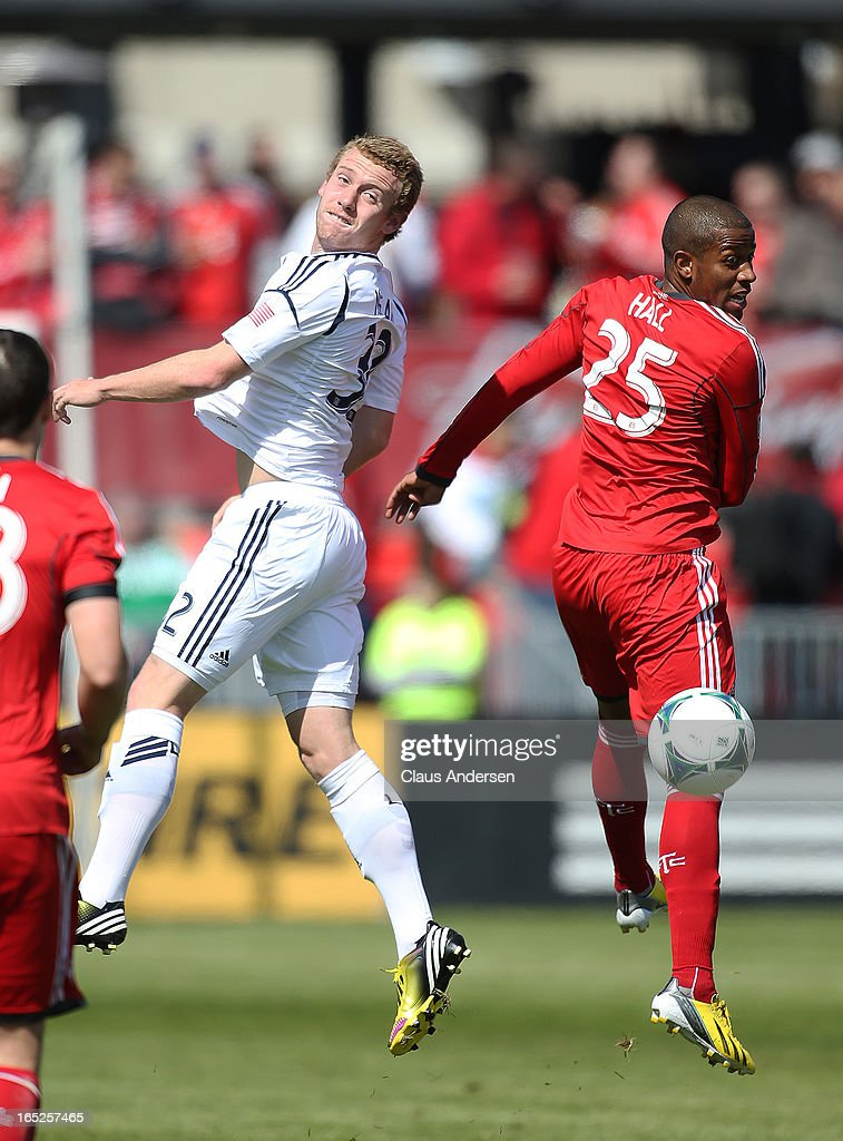 Jack McBean #32 of the Los Angeles Galaxy plays a ball back as Jeremy Hall #25 of Toronto FC watches in an MLS game on March 30, 2013 at BMO field in Toronto, Ontario, Canada. The LA Galaxy and the Toronto FC played to a 2-2 tie.