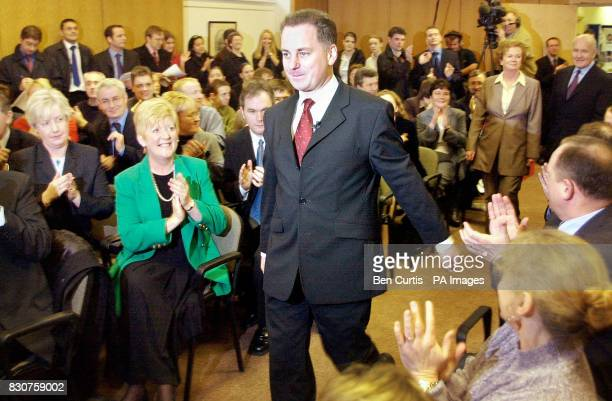 Jack McConnell walks past applauding party supporters as he is elected Leader of the Labour Party in the Scottish Parliament at a party meeting held...