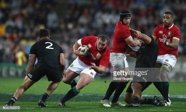 Jack McGrath of the Lions runs with the ball during the match between the New Zealand All Blacks and the British Irish Lions at Westpac Stadium on...