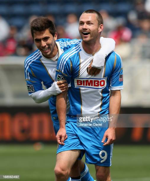 Jack McInerney and Michael Farfan of the Philadelphia Union celebrate McInerney's game winning goal against Chicago Fire during an MLS match at...
