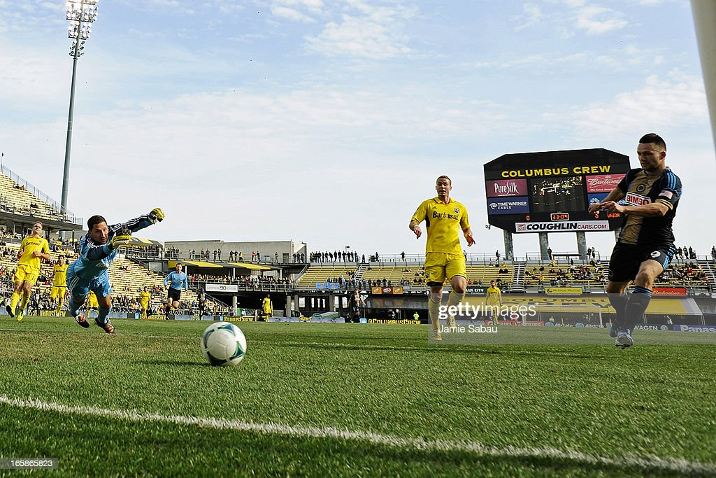 Jack McInerney #9 of Philadelphia Union kicks in the ball for a goal past goalkeeper Andy Gruenebaum #30 of the Columbus Crew in the first half on April 6, 2013 at Crew Stadium in Columbus, Ohio. Columbus and Philadelphia played to a 1-1 tie.