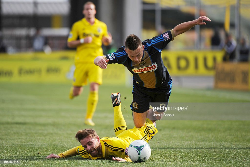 Jack McInerney #9 of Philadelphia Union trips over a fallen Eddie Gaven #12 of the Columbus Crew in the first half while battling for control of the ball on April 6, 2013 at Crew Stadium in Columbus, Ohio.