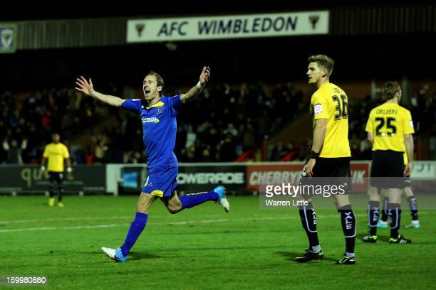 Jack Midson of AFC Wimbledon celebrates scoring the opening goal during the npower League Two match between AFC Wimbledon and Port Vale at The Cherry...