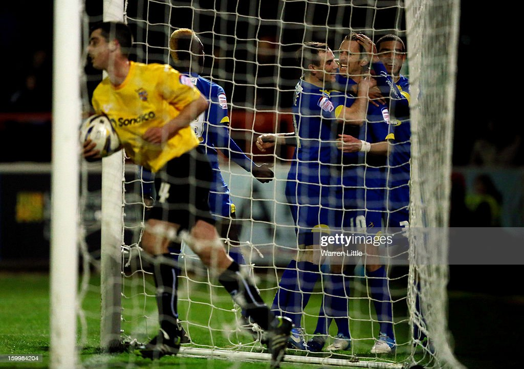 Jack Midson of AFC Wimbledon is congratulated by his team mates after converting a penalty to score his second goal during the npower League Two match between AFC Wimbledon and Port Vale at The Cherry Red Records Stadium on January 24, 2013 in Kingston upon Thames, England.
