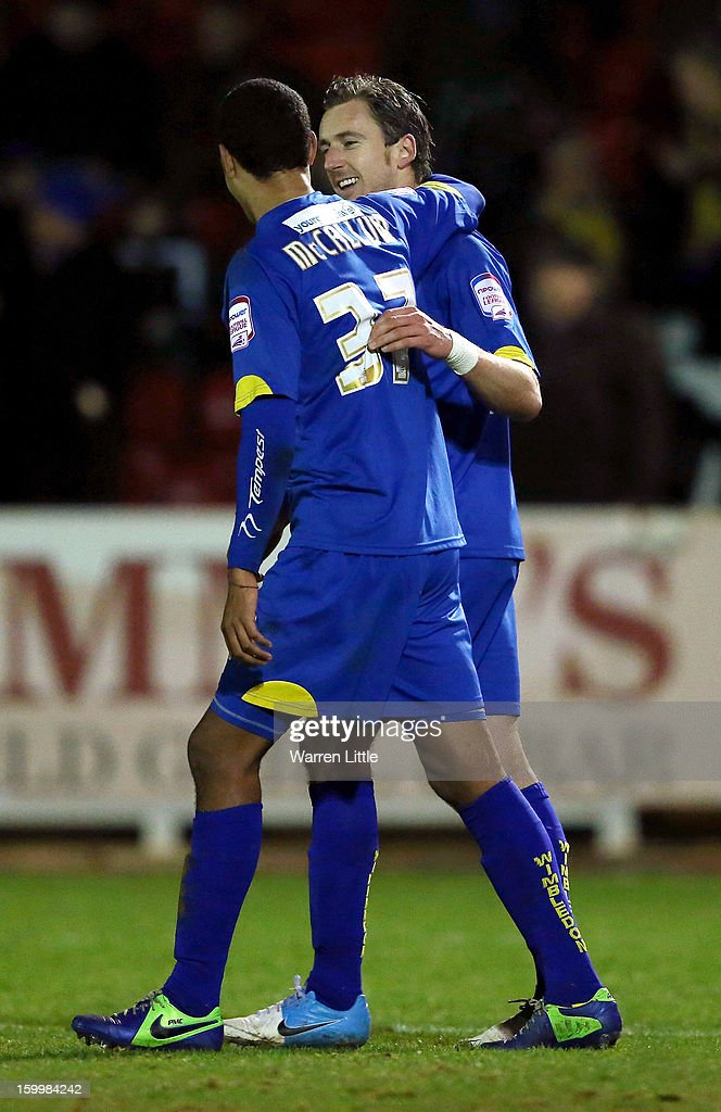 Jack Midson of AFC Wimbledon is congratulated by Paul McCallum after converting a penalty to score his second goal during the npower League Two match between AFC Wimbledon and Port Vale at The Cherry Red Records Stadium on January 24, 2013 in Kingston upon Thames, England.