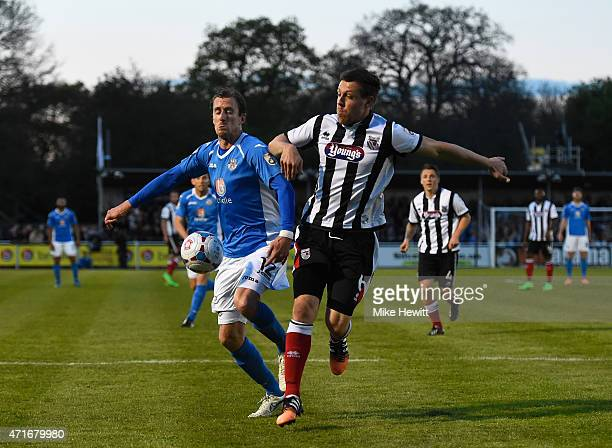 Jack Midson of Eastleigh is challenged by Carl Magnay of Grimsby during the Vanarama Football Conference League play off 1st leg match between...