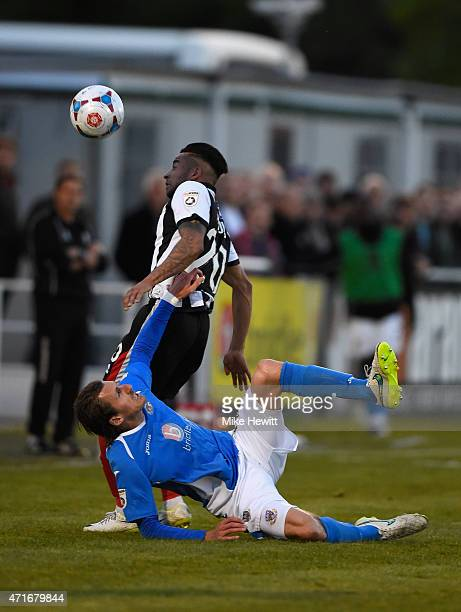 Jack Midson of Eastleigh is fouled by Nathan Arnold of Grimsby during the Vanarama Football Conference League play off 1st leg match between...