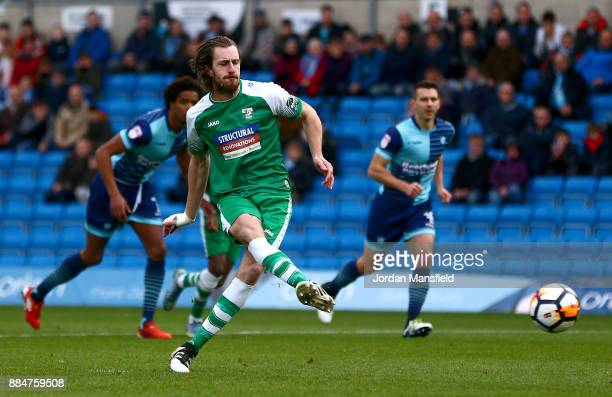 Jack Midson of Letherhead scores his sides first goal from the penalty spot during The Emirates FA Cup Second Round between Wycombe Wanderers and...