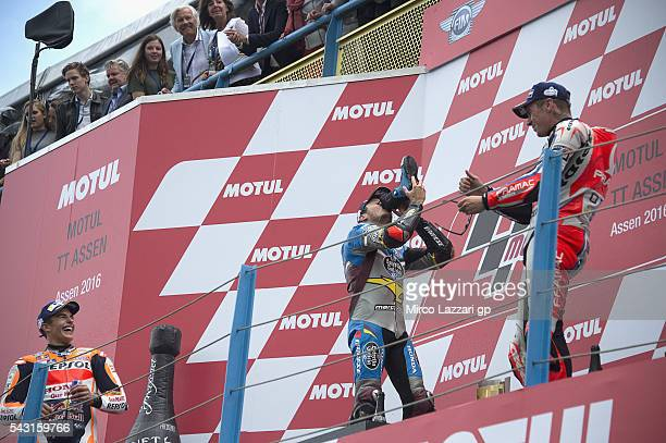 Jack Miller of Australia and Marc VDS Racing Team drinks champagne from the boot and celebrates on the podium his first victory on the MotoGP race at...