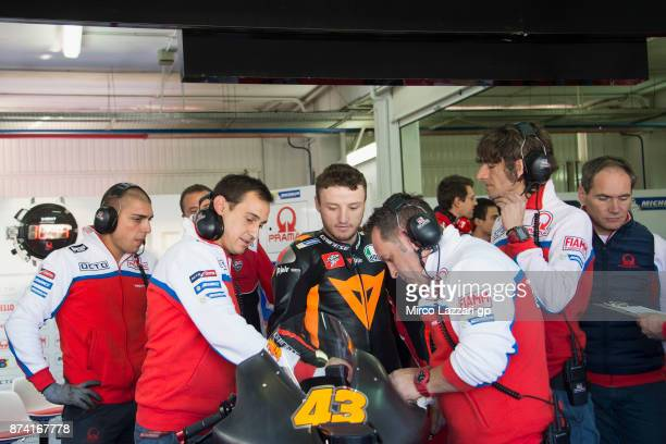Jack Miller of Australia and Octo Pramac Racing speaks with mechanics near the bike in box during the MotoGP Tests In Valencia day 1 at Comunitat...