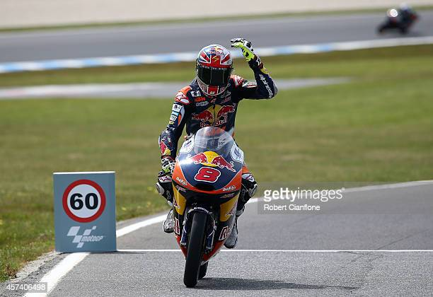 Jack Miller of Australia and rider of the Red Bull KTM AJO ATM gestures as he enters the pits during the qualifying session for the Moto3 at the 2014...