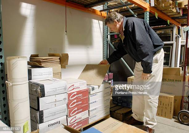 Steve Bolton executive director of Habitat for Humanity Greater Portland looks at imported ceramic floor tiles Thursday December 6 at ReStore the...