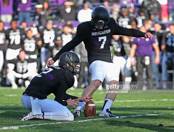 Jack Mitchell of the Northwestern Wildcats kicks the gamewinning field goal out of the hold of Christian Salem against the Penn State Nittany Lions...