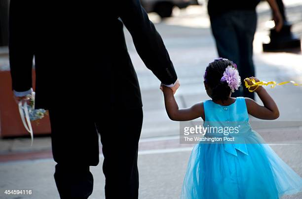 Jack Montgomery and newlyadopted daughter Ravyn walk to the restaurant where they will celebrate the adoption and Montgomery will marry longtime...