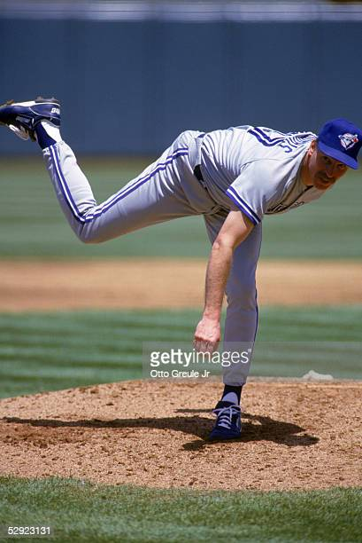 Jack Morris of the Toronto Blue Jays delivers a pitch during a game against the Oakland Athletics at Oakland/Alameda County Coliseum on July 26 1992...