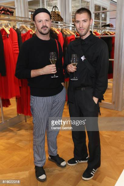 Jack Moss and Joel Traptow attends the Dior cocktail party to celebrate the launch of Dior Catwalk by Alexander Fury on July 19 2017 in London England