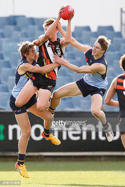 Jack Musgrave of Northern Territory takes a strong mark during the U18 Championships match between NSW/ACT and Northern Territory at Simonds Stadium...