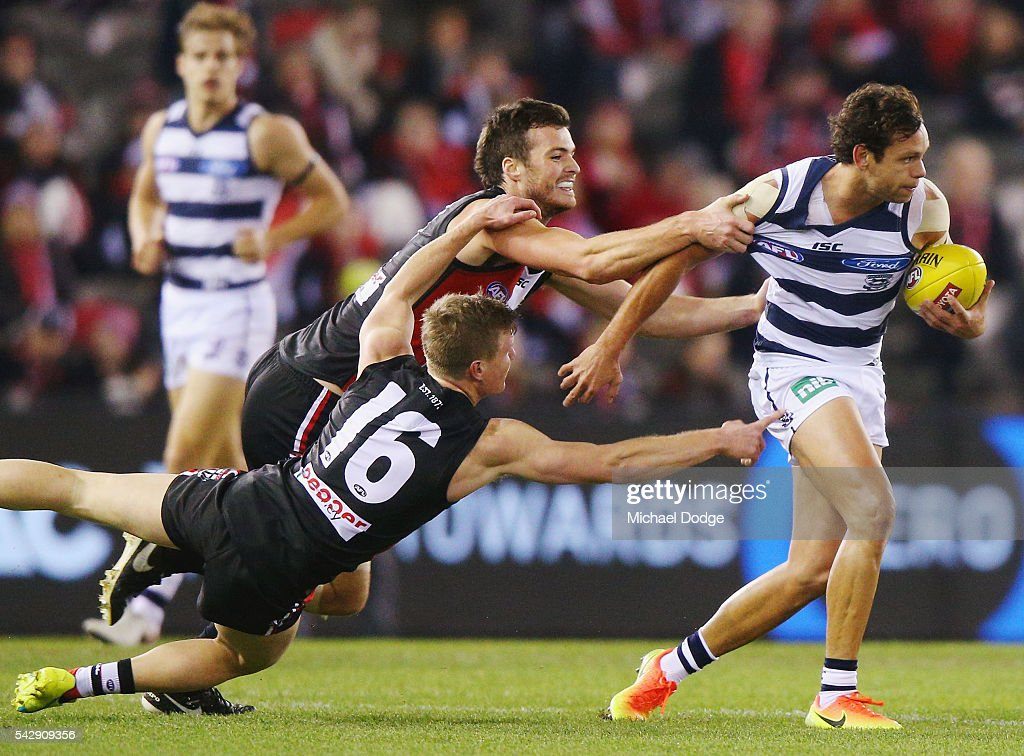 Jack Newnes (L) and Dylan Roberton tackle Steven Motlop of the Cats during the round 14 AFL match between the St Kilda Saints and the Geelong Cats at Etihad Stadium on June 25, 2016 in Melbourne, Australia.