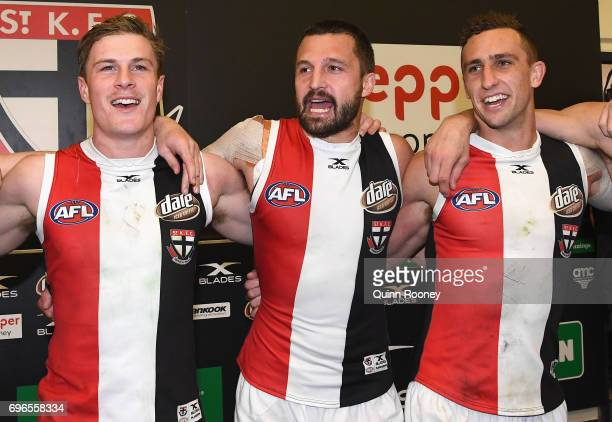 Jack Newnes Jarryn Geary and Luke Dunstan of the Saints sing the song in the rooms after winning the round 13 AFL match between the North Melbourne...