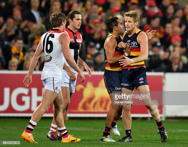 Jack Newnes of St Kilda and Rory Sloane of the Crows react during the round 12 AFL match between the Adelaide Crows and the St Kilda Saints at...