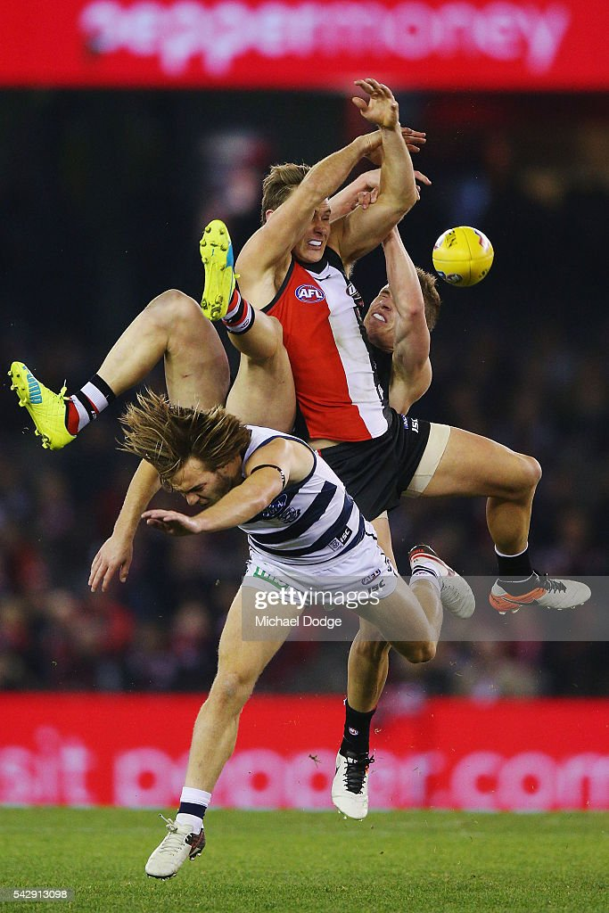 Jack Newnes of the Saints and David Armitage of the Saints compete for the ball over Cory Gregson of the Cats during the round 14 AFL match between the St Kilda Saints and the Geelong Cats at Etihad Stadium on June 25, 2016 in Melbourne, Australia.
