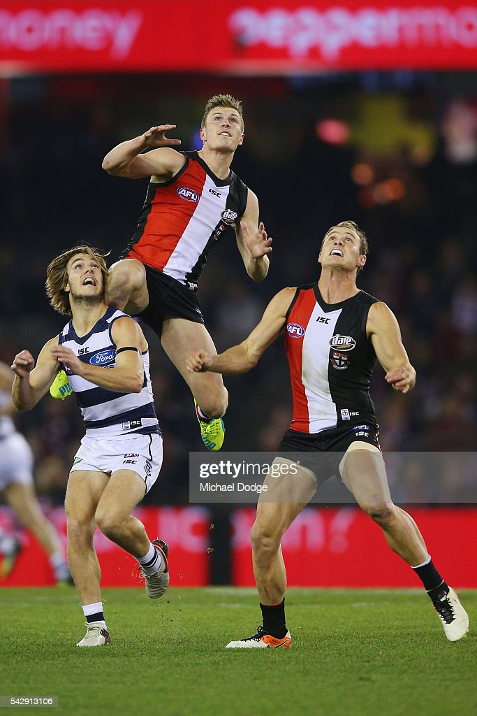 Jack Newnes (top) of the Saints and David Armitage of the Saints compete for the ball over Cory Gregson of the Cats during the round 14 AFL match between the St Kilda Saints and the Geelong Cats at Etihad Stadium on June 25, 2016 in Melbourne, Australia.