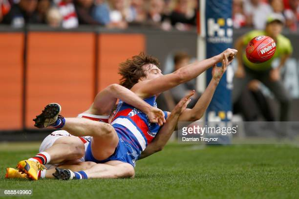 Jack Newnes of the Saints tackles Liam Picken of the Bulldogs during the round 10 AFL match between the Western Bulldogs and the St Kilda Saints at...