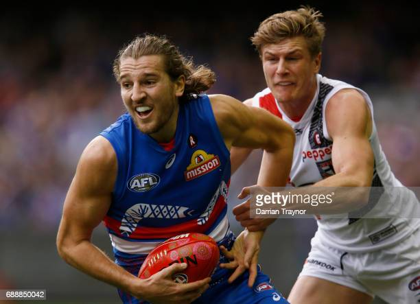 Jack Newnes of the Saints tackles Marcus Bontempelli of the Bulldogs during the round 10 AFL match between the Western Bulldogs and the St Kilda...