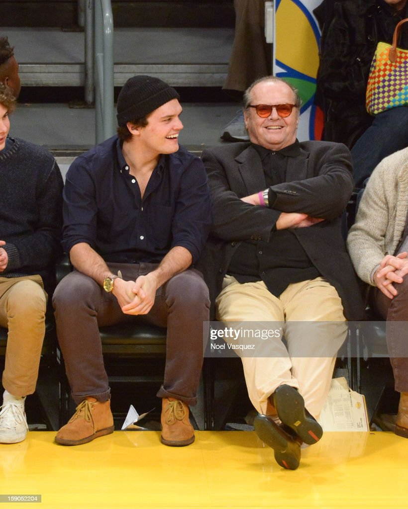 Jack Nicholson (R) and his son Raymond Nicholson attend a basketball game between the Denver Nuggets and the Los Angeles Lakers at Staples Center on January 6, 2013 in Los Angeles, California.