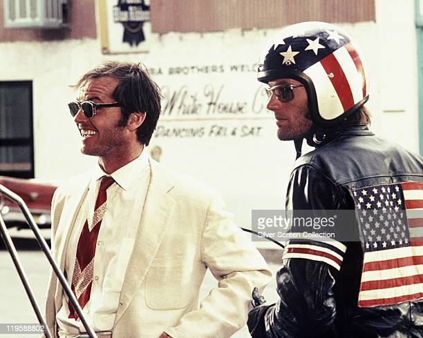 Jack Nicholson and Peter Fonda wearing a starsandstripes helmet and matching leather jacket in a publicity still issued for the film 'Easy Rider' USA...