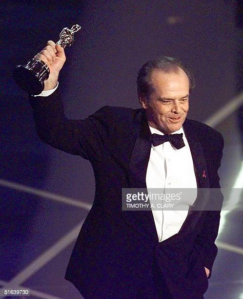 Jack Nicholson holds up his Oscar after winning the Best Actor in a Leading Role Category during the 70th Academy Awards at the Shrine Auditorium 23...