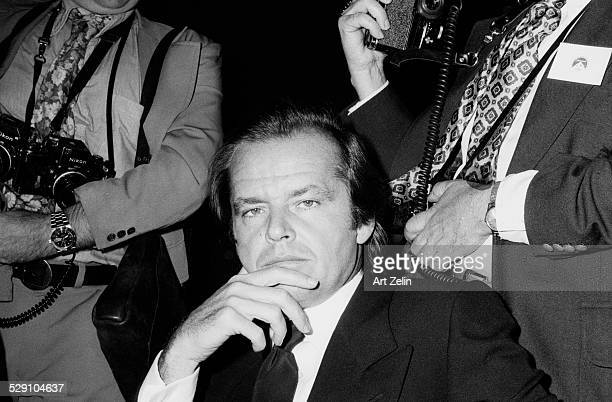 Jack Nicholson seated in front of photographers circa 1970 New York