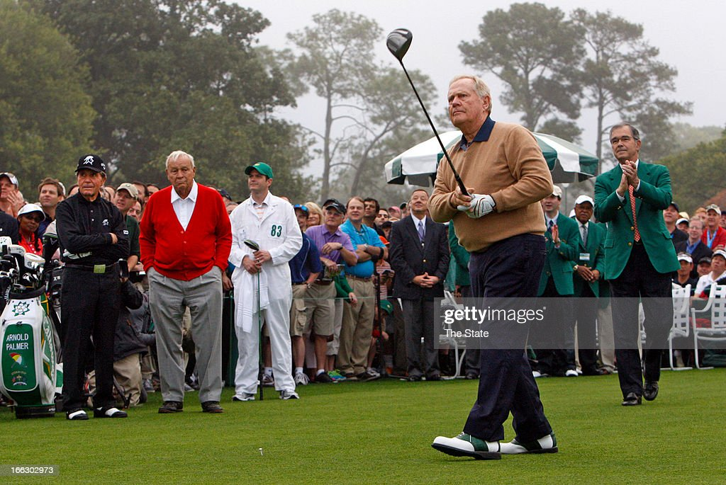 Jack Nicklaus along with Gary Player and Arnold Palmer watches his tee shot in the ceremonial opening to begin the first round of the Masters...