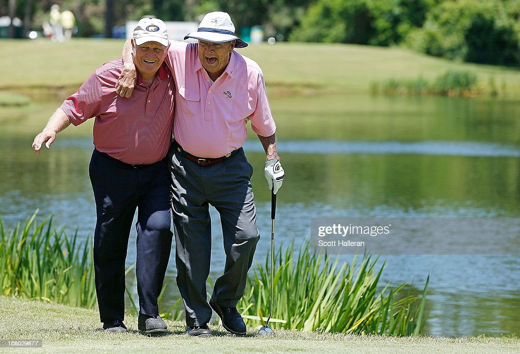 Jack Nicklaus (L) and Arnold Palmer walk to the third green during the Greats of Golf exhibition at the Insperity Championship at the Woodlands Country Club on May 4, 2013 in Woodlands, Texas.