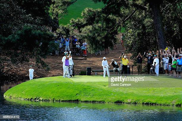 Jack Nicklaus celebrates his holeinone on the fourth hole during the Par 3 Contest prior to the start of the 2015 Masters Tournament at Augusta...