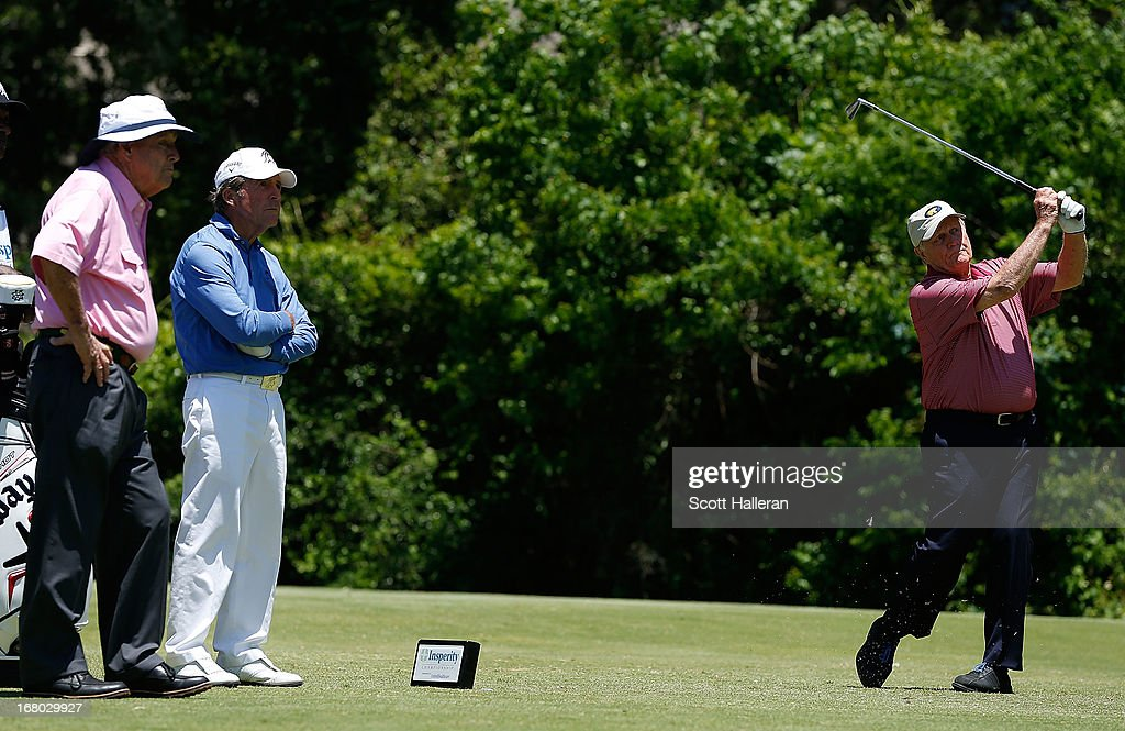 Jack Nicklaus hits a shot as Arnold Palmer and Gary Player look on during the Greats of Golf exhibition at the Insperity Championship at the Woodlands Country Club on May 4, 2013 in Woodlands, Texas.