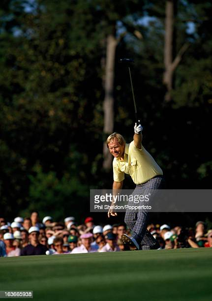 Jack Nicklaus of the United States holes a birdie putt at the 17th during the US Masters Golf Tournament held at the Augusta National Golf Club in...
