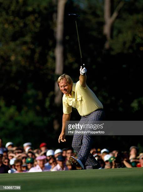 Jack Nicklaus of the United States sinks a birdie putt at the 17th hole during the US Masters Golf Touranment held at the Augusta National Golf Club...