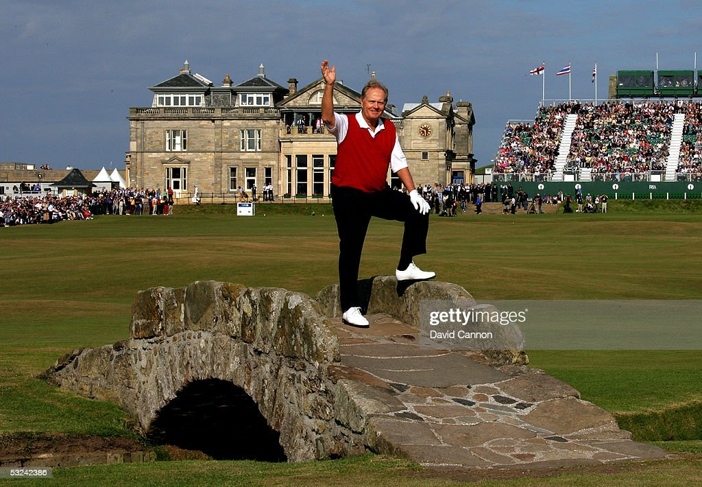 Jack Nicklaus of the USA waves to the crowd as he stands on the Swilcan bridge at what could be his last British Open during the second round of the...