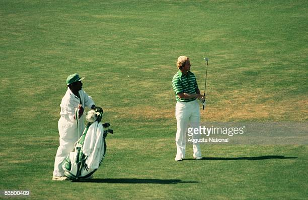 Jack Nicklaus watches his shot from the fairway with his caddie during the 1978 Masters Tournament at Augusta National Golf Club in April 1978 in...