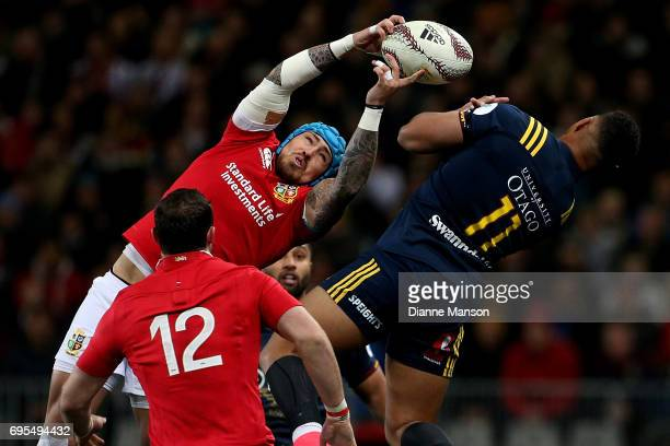 Jack Nowall of the Lions and Tevita Li of the Highlanders compete for a high ball during the match between the Highlanders and the British Irish...