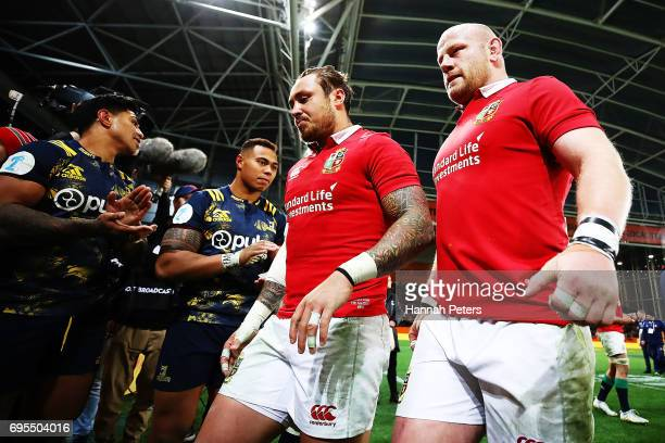 Jack Nowell and Dan Cole of the Lions walk off after losing the match between the Highlanders and the British Irish Lions at Forsyth Barr Stadium on...