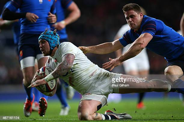 Jack Nowell of England beats the tackle of Rory Kockott of France to score England's seventh try during the RBS Six Nations match between England and...