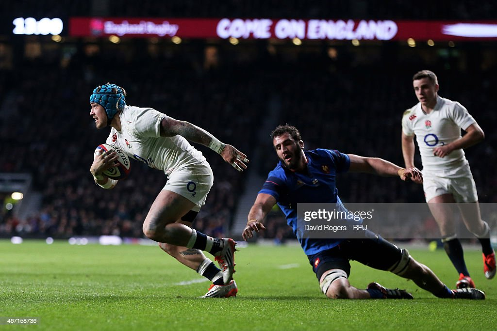 <a gi-track='captionPersonalityLinkClicked' href=/galleries/search?phrase=Jack+Nowell&family=editorial&specificpeople=7377985 ng-click='$event.stopPropagation()'>Jack Nowell</a> of England beats <a gi-track='captionPersonalityLinkClicked' href=/galleries/search?phrase=Yoann+Maestri&family=editorial&specificpeople=6704761 ng-click='$event.stopPropagation()'>Yoann Maestri</a> of France to score England's fifth try during the RBS Six Nations match between England and France at Twickenham Stadium on March 21, 2015 in London, England.