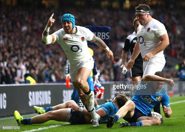 Jack Nowell of England celebrates scoring his teams fifth try during the RBS Six Nations match between England and Italy at Twickenham Stadium on...