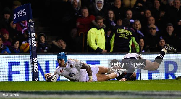 Jack Nowell of England dives over despite the tackle from Tommy Seymour of Scotland to score his team's second try during the RBS Six Nations match...