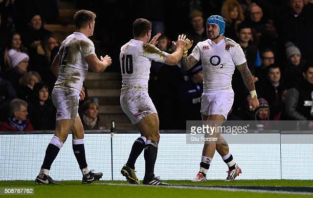 Jack Nowell of England is congratulated by teammates George Ford and Owen Farrell after scoring his team's second try during the RBS Six Nations...