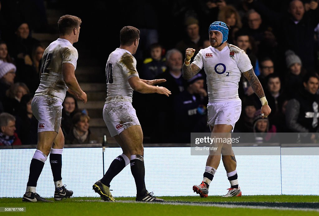 <a gi-track='captionPersonalityLinkClicked' href=/galleries/search?phrase=Jack+Nowell&family=editorial&specificpeople=7377985 ng-click='$event.stopPropagation()'>Jack Nowell</a> of England is congratulated by teammates <a gi-track='captionPersonalityLinkClicked' href=/galleries/search?phrase=George+Ford+-+Rugby+Union+Player&family=editorial&specificpeople=11374128 ng-click='$event.stopPropagation()'>George Ford</a> and <a gi-track='captionPersonalityLinkClicked' href=/galleries/search?phrase=Owen+Farrell&family=editorial&specificpeople=4809668 ng-click='$event.stopPropagation()'>Owen Farrell</a> after scoring his team's second try during the RBS Six Nations match between Scotland and England at Murrayfield Stadium on February 6, 2016 in Edinburgh, Scotland.