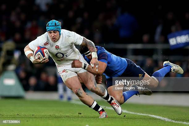 Jack Nowell of England is tackled by Maxime Mermoz of France during the RBS Six Nations match between England and France at Twickenham Stadium on...