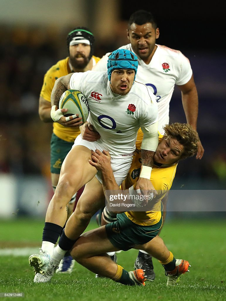 Jack Nowell of England is tackled by Michael Hooper during the International Test match between the Australian Wallabies and England at Allianz Stadium on June 25, 2016 in Sydney, Australia.